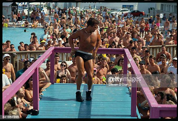 A young man lowers his underwear during a Spring Break competition in Daytona Beach The winner of the strip contest will have the honor of pouring...