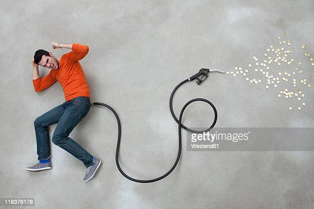 Young man lying on industrial hose