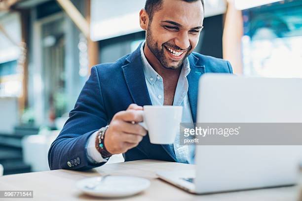 young man making business in the coffee break - naher und mittlerer osten stock-fotos und bilder