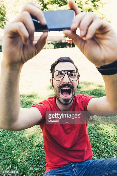 Young man making selfie in the park