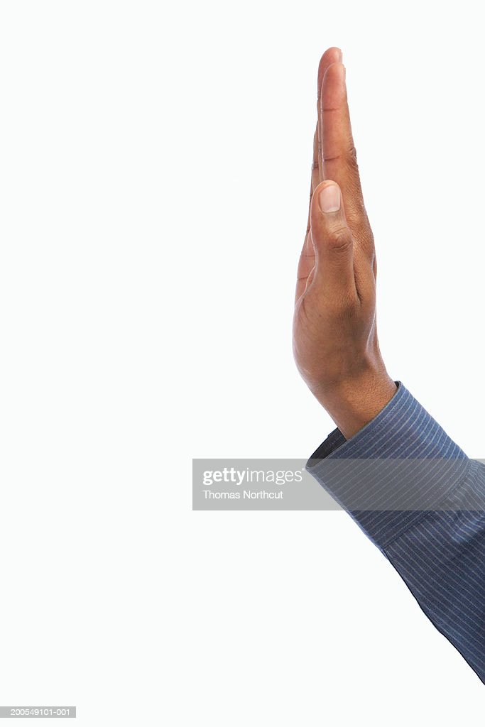 Young man making stop gesture, side view, close-up of hand : Stock Photo