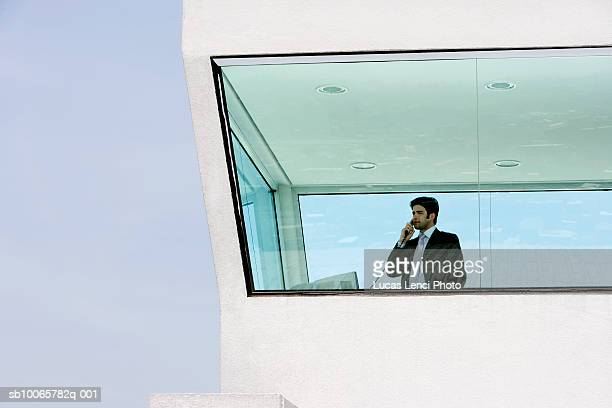 Young man man on telephone inside control tower