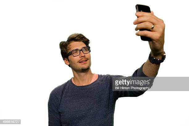 Young man mobile camera selfie