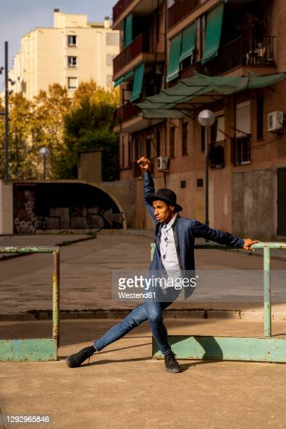 young man moving and dancing outdoors - one man only stock pictures, royalty-free photos & images