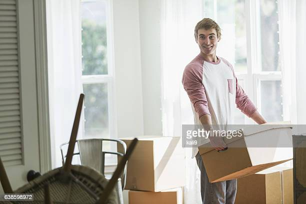 Young man moving into house or apartment