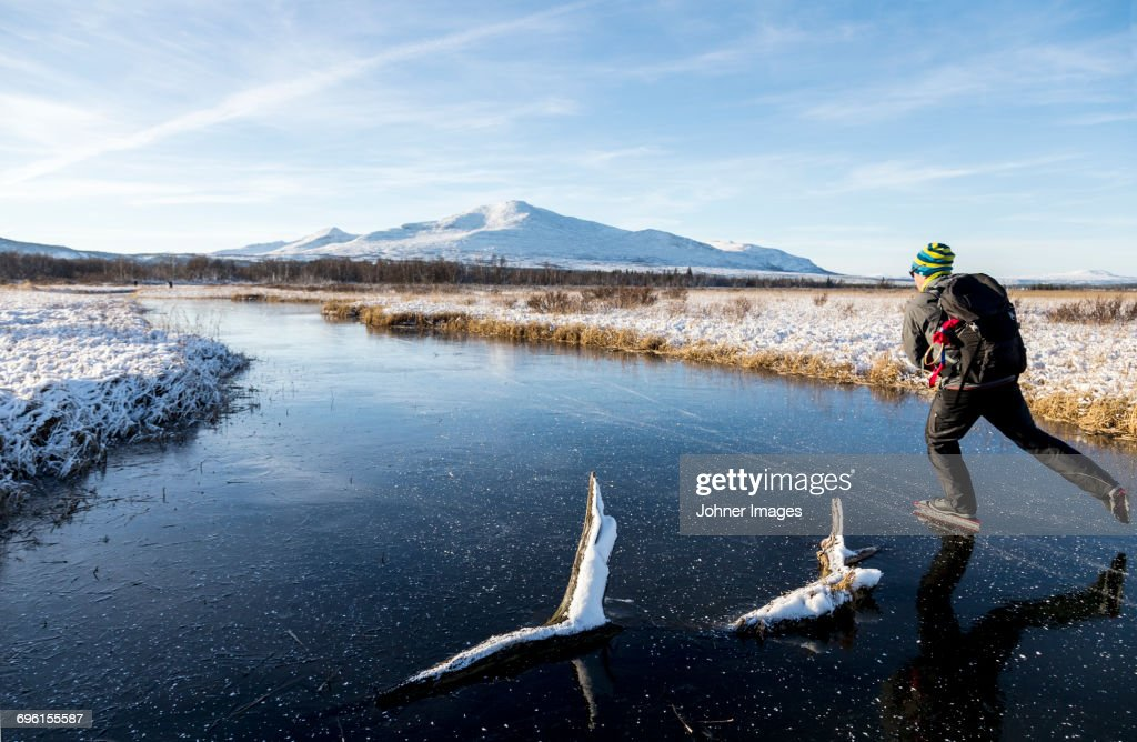 Young man moving on ice : Stock Photo
