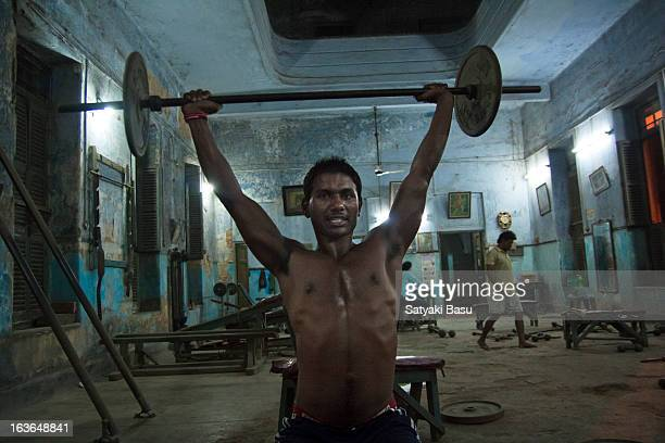CONTENT] A young man of low socioeconomic background exercising in a free gym maintained by local club The room is huge but very old and dirty and...