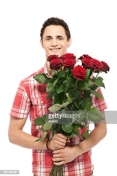 Junger Mann mit Rosen
