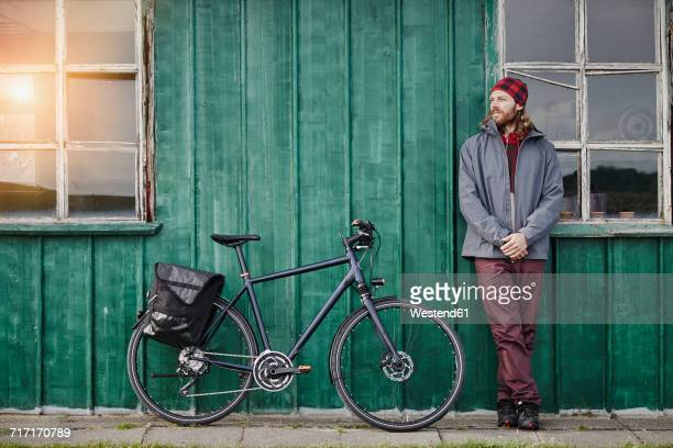 Young man on a bicycle tour having a break