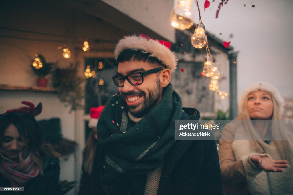 Young man on a Christmas celebration : Stock Photo