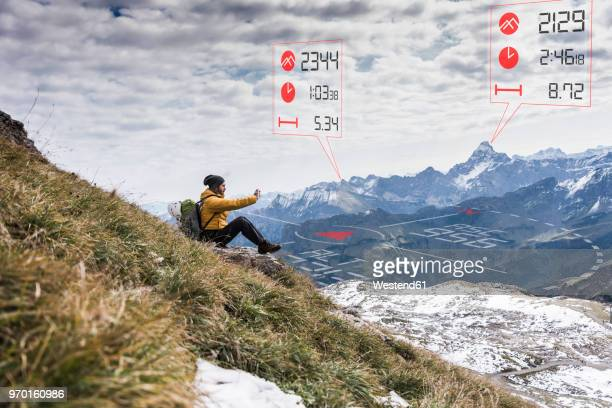 young man on a hiking trip with data emerging from smartphone - data lake bildbanksfoton och bilder