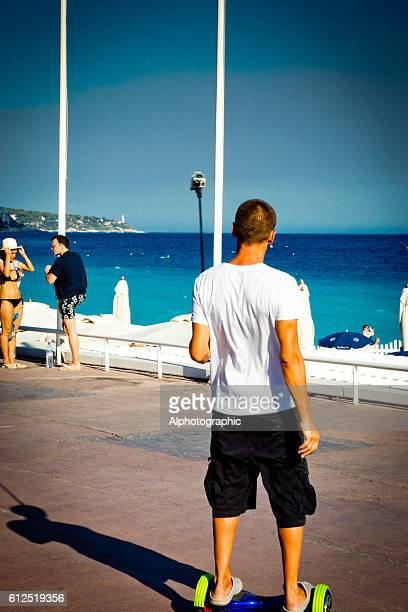 young man on a hoverboard - hoverboard stockfoto's en -beelden