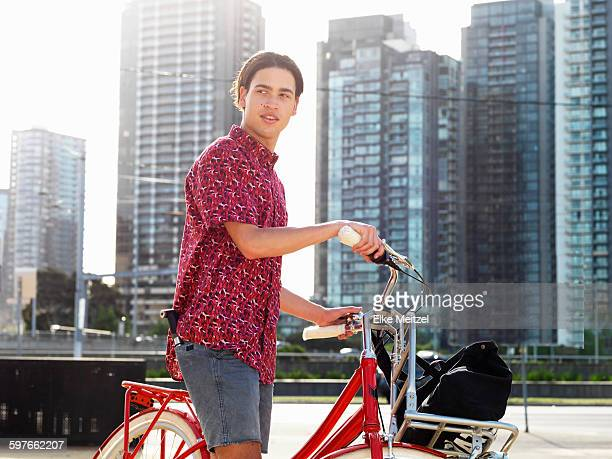 Young man on bicycle, Southbank, Melbourne, Australia