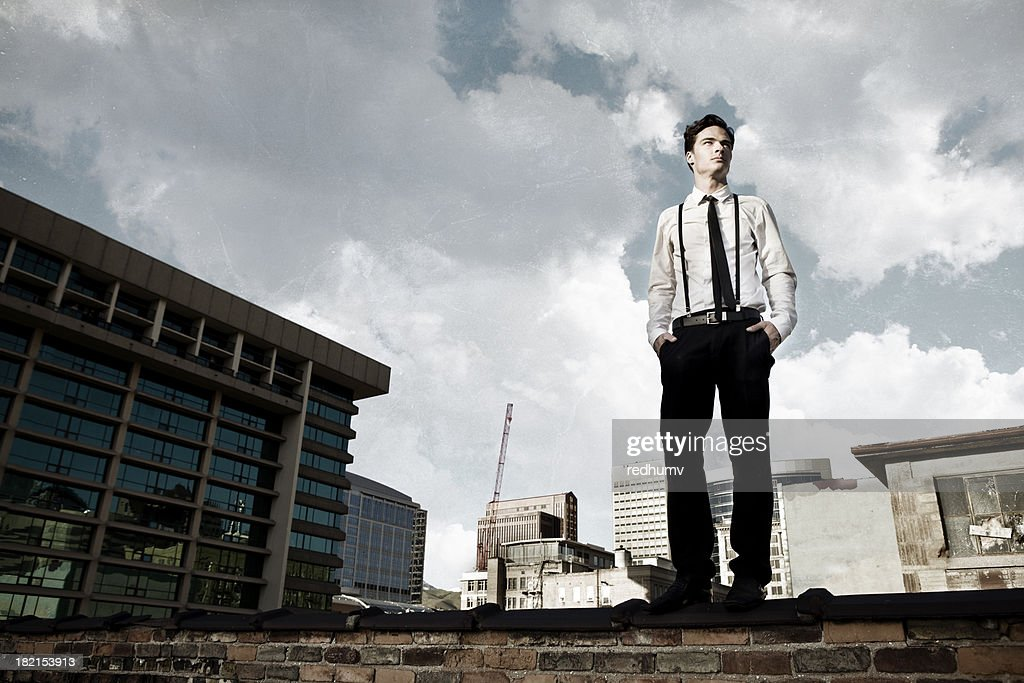 Young Man on City Rooftop : Stock Photo
