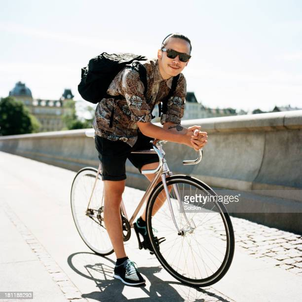 young man on his bicycle in city area