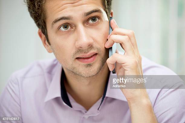 young man on mobile phone - only young men stock pictures, royalty-free photos & images