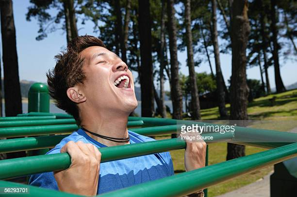 Young man on monkey bars