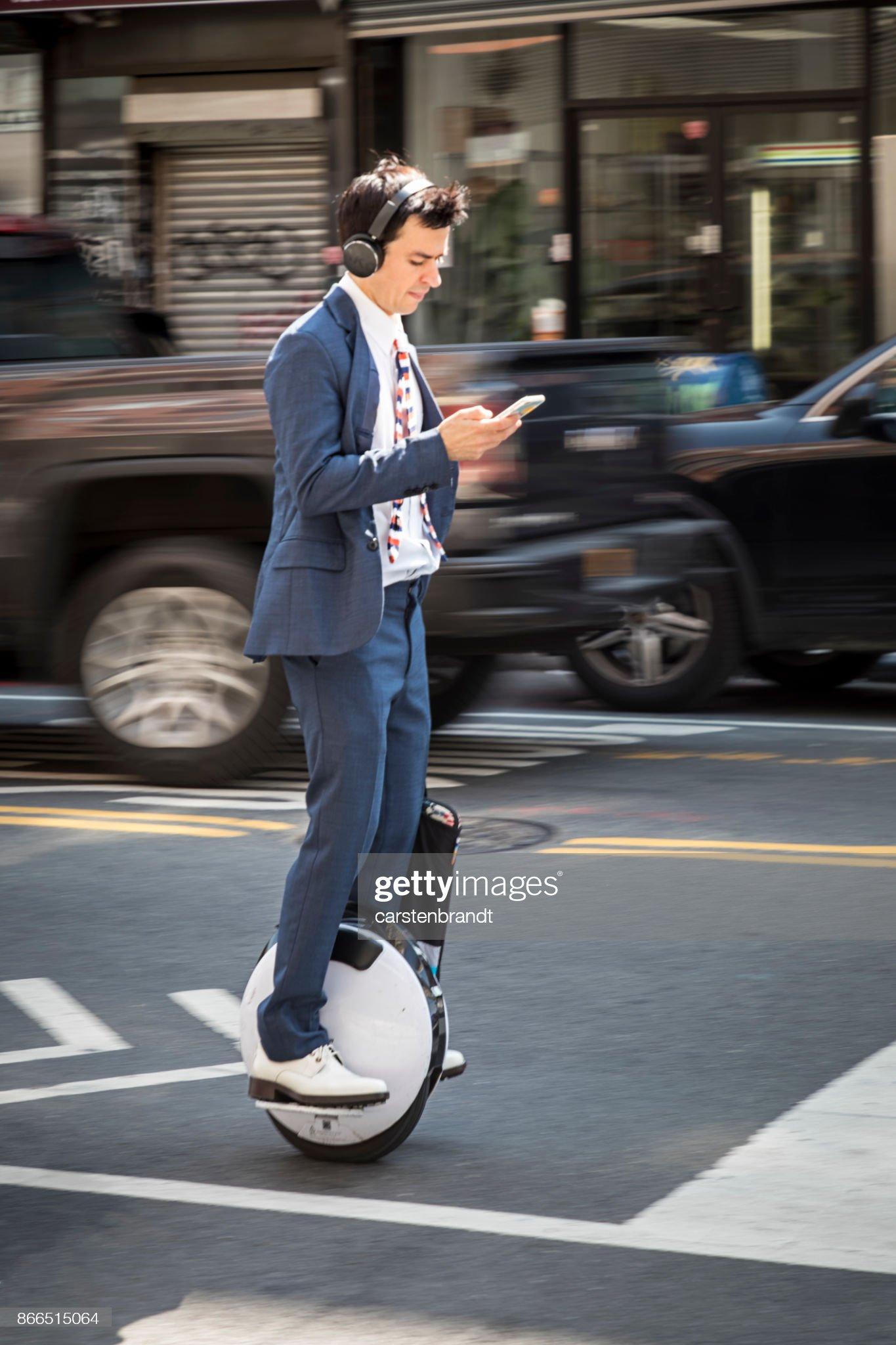 Young man on monowheel : Foto stock