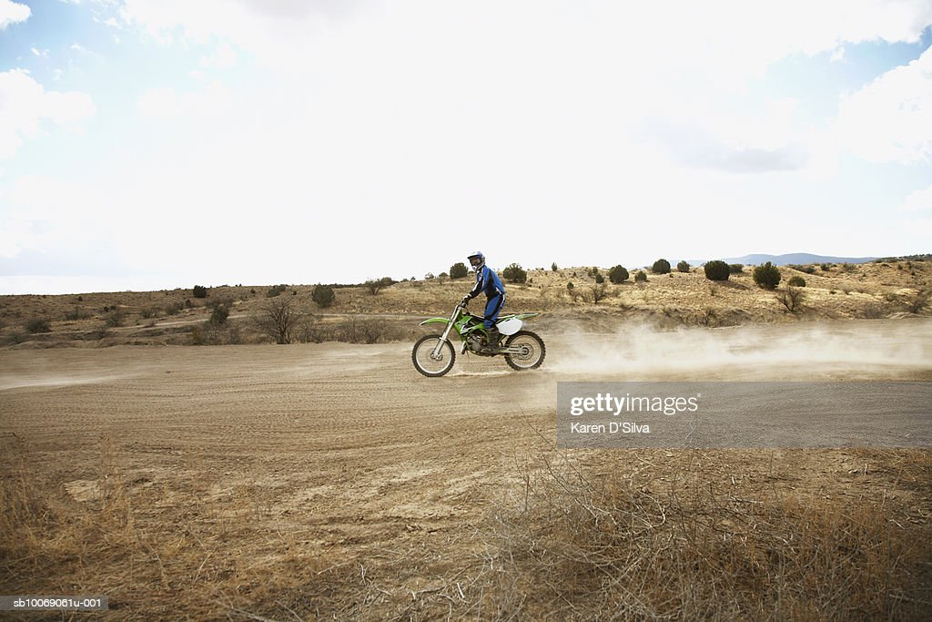 Young man on motocross bike : Stockfoto