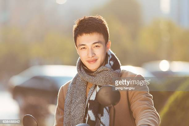 young man on motorcycle in modern city - scarf stock pictures, royalty-free photos & images