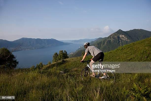 Young man on mountain bike.