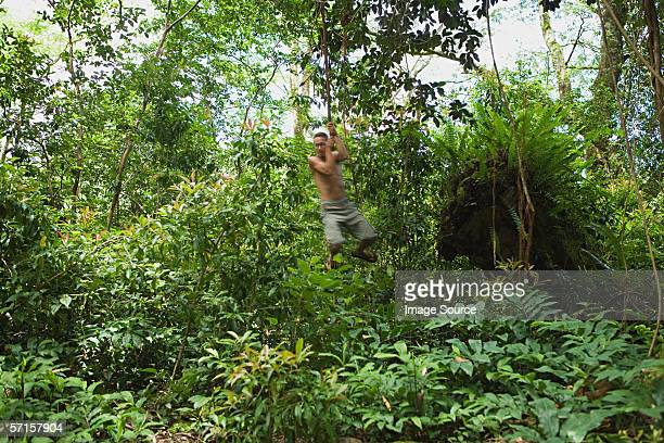 Young man on rope swing