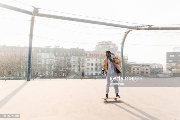 young man on skateboard on court - court hearing stockfoto's en -beelden