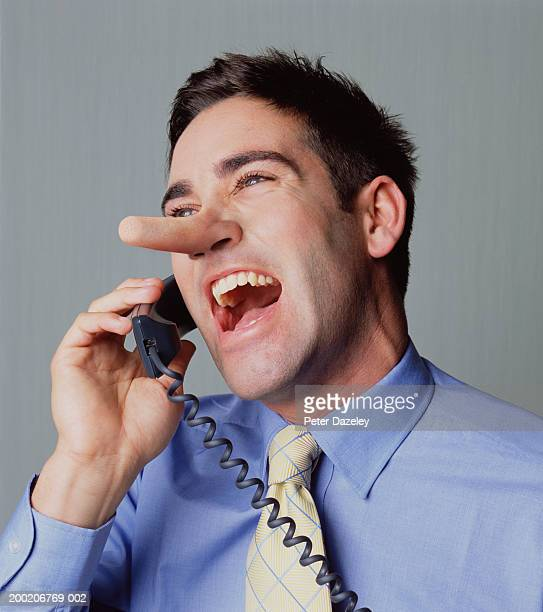 young man on telephone, laughing, close-up - big nose stock photos and pictures