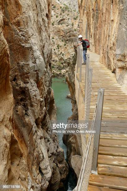 young man on the caminito del rey path known as the 'walkway of death' above guadalhorce river gorge near alora in malaga, spain - caminito del rey fotografías e imágenes de stock