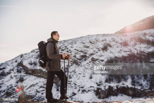Young man on the top of the mountain
