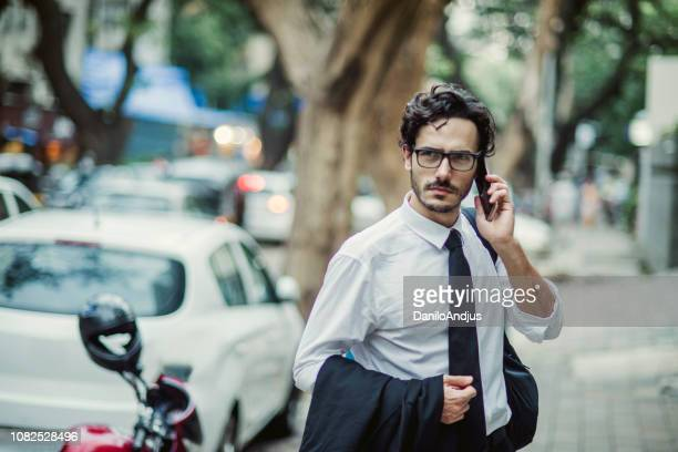 young man on the way from work - formal stock pictures, royalty-free photos & images