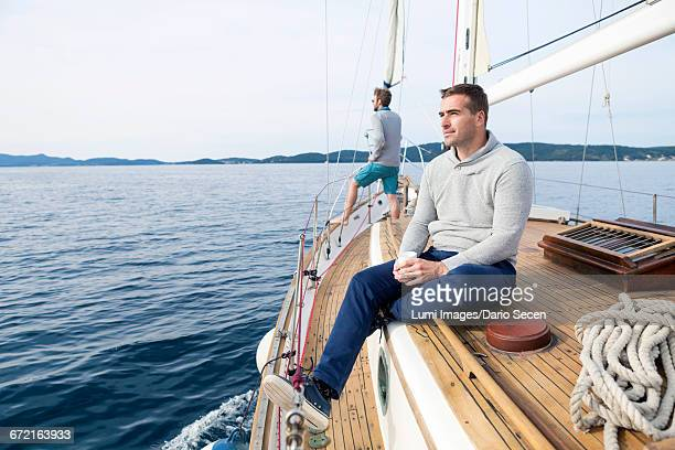 Young man on yacht day dreaming
