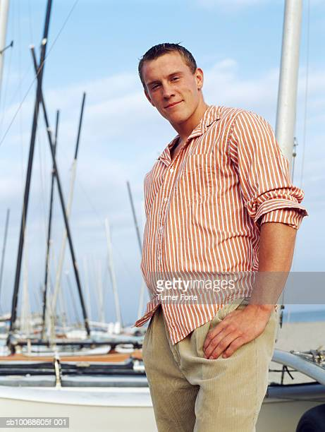 Young man on yacht, portrait