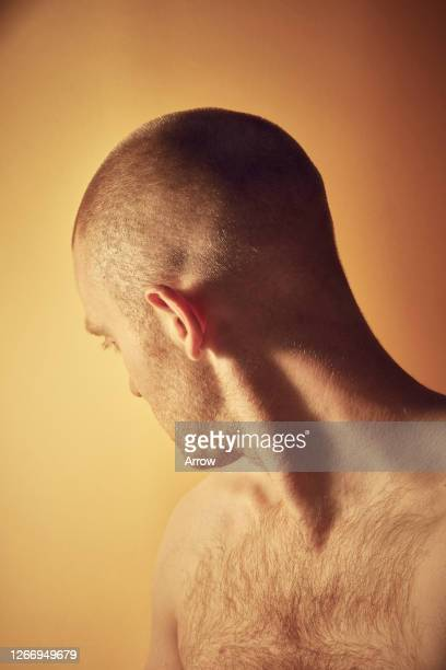 young man on yellow background - hairy chest stock pictures, royalty-free photos & images