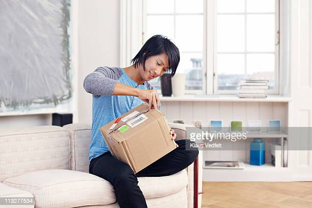 Young man opening package