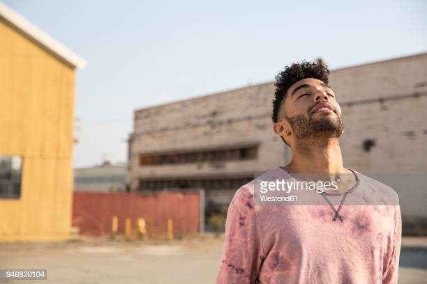 young man outdoors leaning back - bending over backwards stock photos and pictures