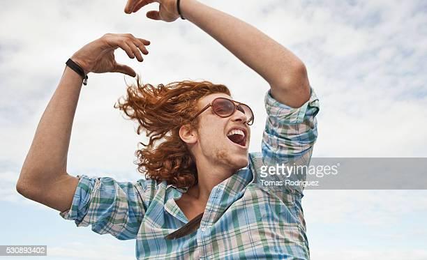 young man outdoors - 喜び ストックフォトと画像