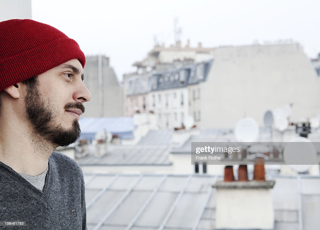 young man overlooking Paris. : ストックフォト