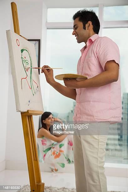 Junger Mann Malerei seine Freundin