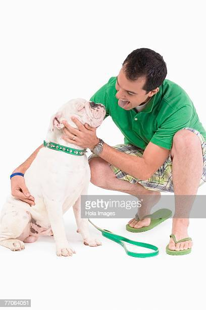 Young man pampering a dog