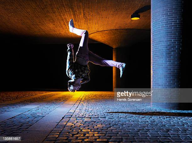young man performing a jump in urban environment