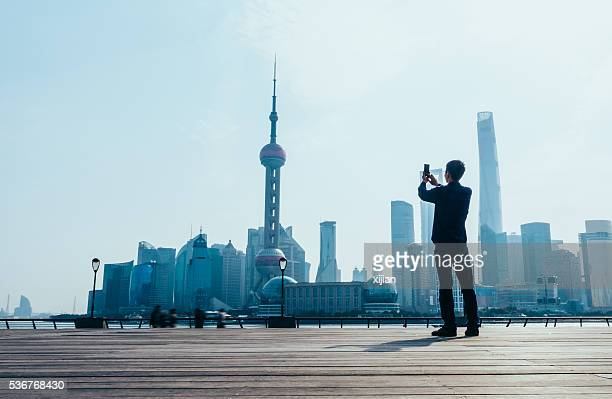 Young man photographing city
