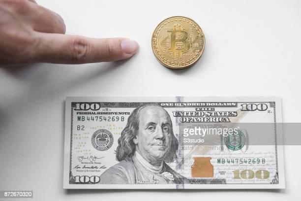 A young man picking between a visual representation of the digital Cryptocurrency Bitcoin and US Dollar on November 9 2017 in Hong Kong Hong Kong...
