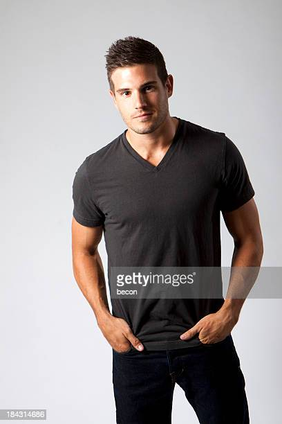 young man - gray shirt stock pictures, royalty-free photos & images