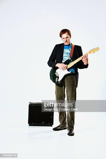 A Young Man Playing An Electric Guitar