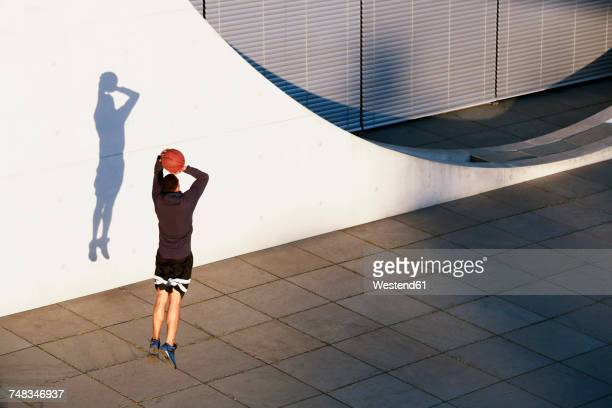 Young man playing basketball in the city