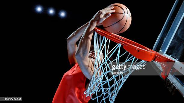 young man playing basketball - shooting baskets stock pictures, royalty-free photos & images