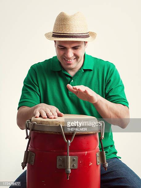 young man playing congas