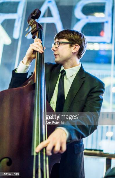 Young man playing contrabasson