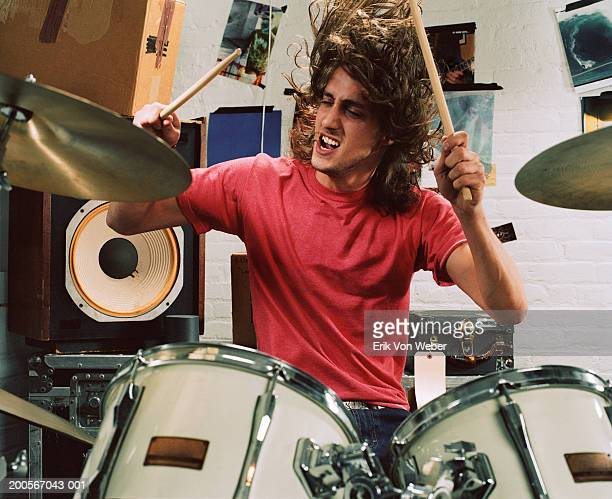 Young man playing drums, front view